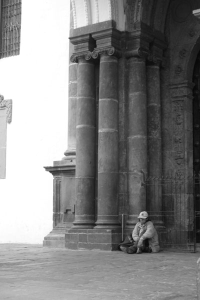 Quito - Beggar in front of cathedral