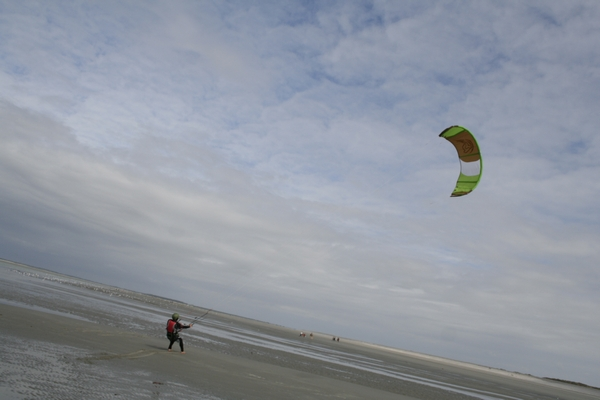 Kite surfer on the beech in Picardie (France)