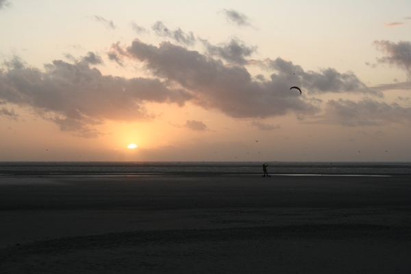 Kite surfer in the sunset at La Molliere beech in Picardie (France)