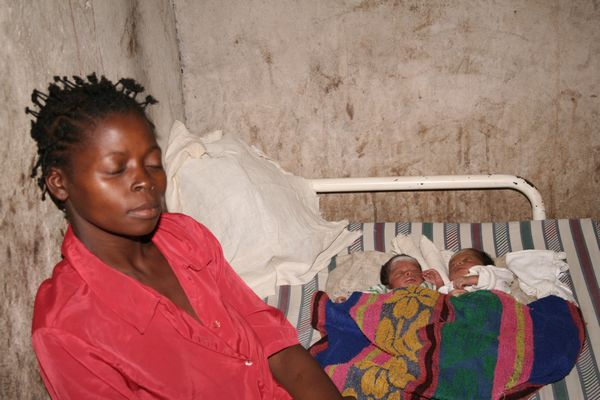 Woman with twin baby girls in Congo