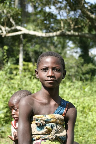 Congo (Dem. Rep.) - girl carrying a baby on her back