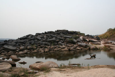 Dry riverbed with piles of rocks